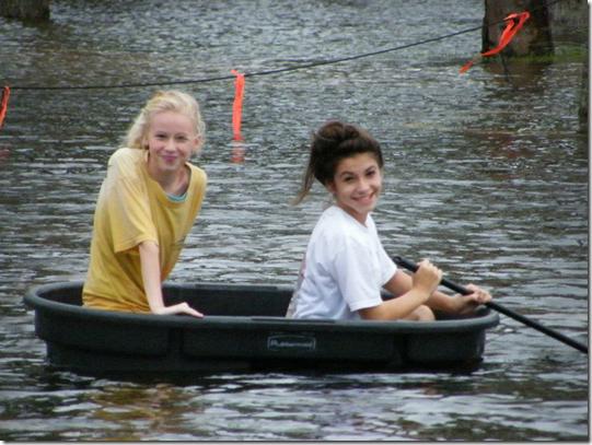 Rebecca McRae and Amanda Perez exploring the high waters of the Tropical Storm Debbie EYEONCITUS.COM