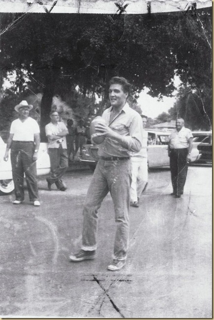 Elvis Presley tossing the football around outside the old courthouse in Inverness, FL 1961  EYEONCITRUS.COM