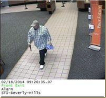 Bank Robbery Suspect walks causually out of the Suntrust Bank with gun in hand       EYEONCITRUS.COM